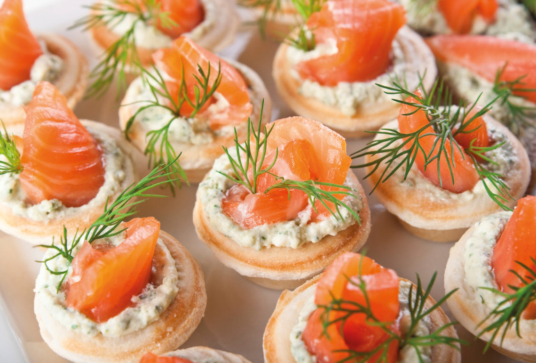 Tasty snacks with salted salmon and cottage cheese filling